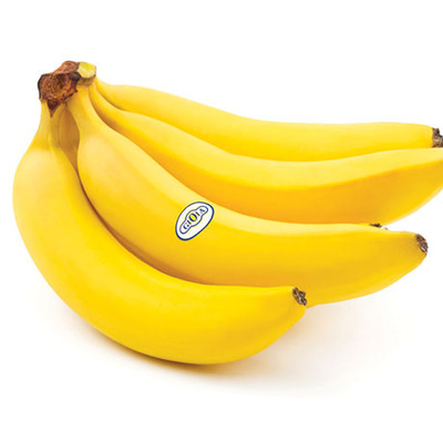 Bananas are ripened locally by exposing them to a controlled environment with temperature set to 15.5° C–16.5° C. Bananas change colour from a deep green to yellow.